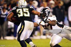 Denver Broncos linebacker Mario Haggan #57 misses a tackel on San Diego Chargers fullback Mike Tolbert #35 at Qualcomm stadium in San Diego. Joe Amon/ The Denver Post