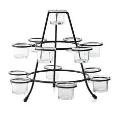 "FRUIT PYRAMID CANDLE CENTERPIECE  Create a pyramid of dazzling light with this unique cone shaped centerpiece. Crafted of iron and wire, it holds thirteen glass candle cups for tealights. Replacing candle cups with your favorite fruit makes a lovely fruit pyramid. 13¾ x 10½""   Retail Price Was $24.00  Item: 512100  $12.00"