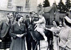 From left, King George VI, Queen Elizabeth II, Prince Philip, Princess Margaret and the Queen Mother look on as a young Prince Charles sits on an ornamental deer in this family portrait of the Royals in the Princess Elizabeth, Princess Margaret, Queen Elizabeth Ii, Young Prince, Prince Phillip, Prince Charles, Intimate Photos, Thing 1, Queen Elizabeth