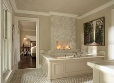 Think outside the box by using lots of candles and incense; create the mood with the help of a fire surround. #DesignIdeas #Bathroom #Fireplace