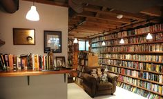 I like the idea of turning a basement library into a kind of faux bookstore vibe