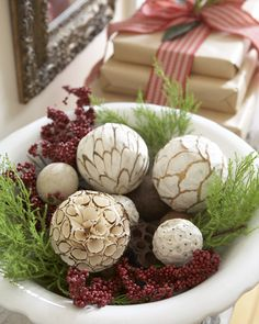 Instead of the traditional pinecones, scour crafts and home stores for natural ornaments to display with seasonal greenery.