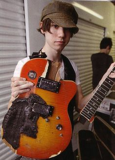 Ryan Ross with his guitar that he lit on fire