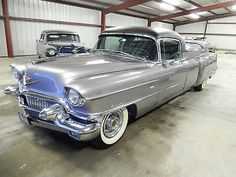 1956 Cadillac Flower Car...Re-pin...Brought to you by #HouseofInsurance for #CarInsurance #EugeneOregon