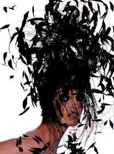 'The Cutting Edge' Vogue US, January 1992. Photographer: Irving Penn Model: Linda Evangelista. Feathered hat by Philip Treacy.