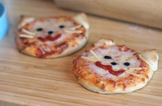 Kitty pizzas! Draw the moth with marinara, use cheese for whiskers and olives for eyes. Cute pizza