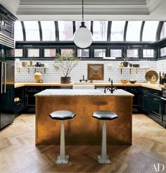 Celebrity Kitchen Decor - Nate Berkus, Ellen DeGeneres, Neil Patrick Harris, and More Photos | Architectural Digest - Love the white subway tile with dark grout and gold accents!