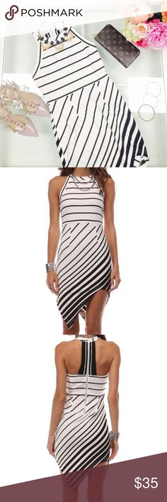 LAST ONE Black and White Asymmetric Dress Super cute Asymmetric stripe dress. 96% polyester and 4% spandex. By tea and cup. Perfect for parties! Tea n Cup Dresses Asymmetrical