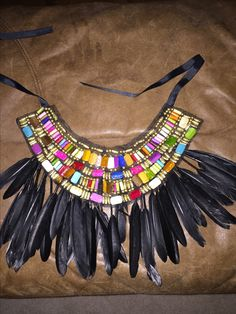 I love the beading and the feathers on this neck piece. It is very colorful and it is very tribal looking which is what I want to base my design off of. Rafiki Lion King, Lion King Play, Lion King Show, Lion King Jr, Musical Rey Leon, Lion King Musical, Lion King Broadway, Rafiki Costume, Lion King Costume