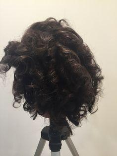 Vertical curls on textured hair