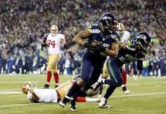 JANUARY 19: Defensive end Michael Bennett #72 of the Seattle Seahawks recovers a fumble by quarterback Colin Kaepernick #7 of the San Francisco 49ers and runs for 17-yards in the fourth quarter during the 2014 NFC Championship at CenturyLink Field on January 19, 2014 in Seattle, Washington. (Photo by Christian Petersen/Getty Images)