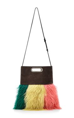 One of fashion's preeminent designers, the Swiss-born, Milan-based Consuelo Castiglioni crafts artful, intellectual fashion for **Marni**, the label she founded in 1994 to complement her husband's fur business. For pre-fall '15, she delivers the tote bag with a typically luxuriant yet subversive twist, with standout technicolor sheep fur adorning this leather bag.