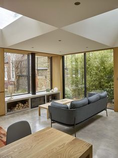 Tucked away:Hidden House was created from a former caretaker's house located in the grounds of a converted Victorian school in London.The single storey home is just72sqm but is flooded with light thanks to carefully placed windows