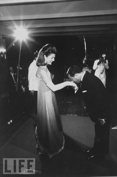 Jackie Kennedy is greeted by Cambodian Prince Norodom Sihanouk upon her arrival to his palace for dinner in 1967.