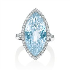 Marquis Swiss blue topaz ring featuring 0.35 tcw F/G VS round brilliant white diamonds and a 13.25 ct marquis shape checkerboard top Swiss blue topaz, measuring 22 x 12mm