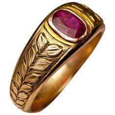 Antique Ruby Men's Ring, made in Moscow between 1908 and 1917 a green 14K gold ring designed as a laurel wreath tiara centered with a cushion cut ruby (approximately 1 carat) set in a rose gold bezel