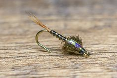 As fall approaches, it is time to switch up your fishing strategy. This is when most anglers focus more on smaller baetis nymph and midge combinations. Walleye Ice Fishing Lures, Trout Fishing Tips, Fly Fishing Nymphs, Blue Winged Olive, Fly Tying Desk, Fly Tying Patterns, Fishing Outfits, Saltwater Fishing, Skinny