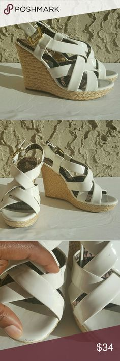 Jessica Simpson Wedges A pair of wedges is a staple for summer!! Grab this pair to go with everything!! These are patent leather and have a couple of scuffs (see photos for details). These shoes are in otherwise great condition.  **All purchases come with a FREE gift!!** Jessica Simpson Shoes Wedges