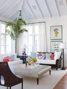 *Love the colorful pillows/accessories and contrast of the dark wood with the light upholstered pieces, as well as the tree