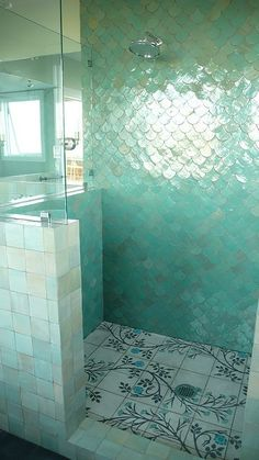 shimmer *mermaid* tile! Perhaps it's because I grew up with a lighthouse-d themed bathroom and then the other one had seashells all over the wallpaper, but I love the idea of having a sea themed bathroom! Perfect