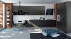 Modern and classic kitchen by Scavolini.  I am not sure what the round blue item is, but taking into account the lamp, I think I can safely assume it is a place for seating.  Scavolini kitchens.