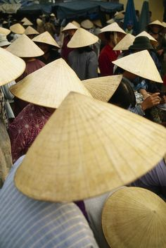 Conical straw hats at a wet market in Hoi An, Vietnam