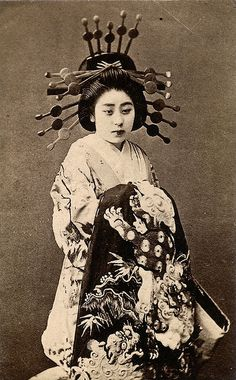 """"""" The Oiran type of high-class prostitutes lived in the brothels and entertainment districts (""""Pleasure Quarters"""") of big cities like Yoshiwara in Edo (now Tokyo), Shimabara in Kyoto, the Shimmachi in Osaka and Maruyama in Nagasaki.   To entertain their clients, oiran practiced the arts of dance, music, poetry and calligraphy, and an educated wit was considered essential to sophisticated conversation."""""""