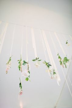 floral garland suspended from tented ceiling // photo by Firm Anchor http://ruffledblog.com/floral-historic-cedarwood-wedding/