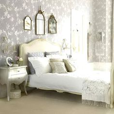 This room has many elements that I love such as birdcages, a sewing mannequin, GREY walls with light accents. Although very vintage, it also has modern elements with the metallic silver bed side table. Love this room!