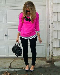 Black and white with a pop of pink (minus the shoes and whatever that black this is on her sweater)