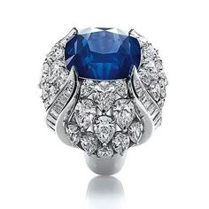 """repost from @frenchbluediamond A magnificent """"Tulip"""" ring set with a central 18.28ct sapphire surrounded by diamonds totaling 8.59cts all in platinum. By- Harry Winston#instarepost20"""