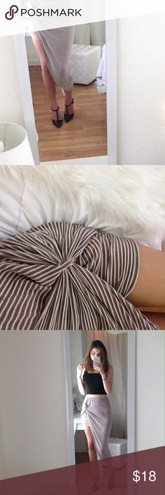 Faux Wrap Skirt Adorable asymmetrical faux wrap skirt, size M. Washed once otherwise perfect condition. Tan and white stripes. I'm 5'8 size xs/s for reference! Charlotte Russe Skirts Asymmetrical