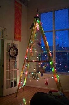 Vintage ladder decorated into a Christmas tree.  Love this!