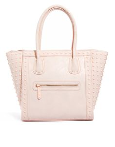 This pale pink ALDO tote is precious... The design reminds me of a Celine Luggage Tote! The studs add edge to the innocence of the pink. $81.46