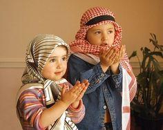 Praying Muslim Children and the arabic dress
