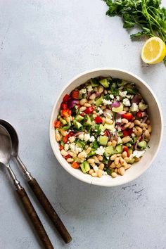 Mediterranean Bean Salad - A satisfying salad perfect for lunch or outdoor bbqs and picnics. This salad also serves as a tasty side dish with grilled chicken, shrimp, or fish. #saladrecipes #salad #beans #beanrecipes #healthylunchideas #glutenfreerecipes