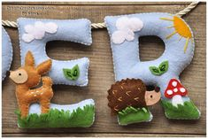 A Woodland animals themed, personalised felt name banner, made of different coloured felt, with decorative rope for hanging it. A lovely present for a new baby, grandchild or child, to display on their wall or room door for many years to come. Suitable for a birthday, christening, easter