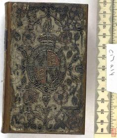 The British Library - Database of Bookbindings - Full Image. Shelfmark c17a14. Nouum Testamentum, Date 1576, With the arms of Elizabeth I. Satin, Embroidered, with silver threads. (possible water color behind some of the embroidered motifs). More info at http://www.bl.uk/catalogues/bookbindings/LargeImage.aspx?RecordId=020-000001426=ImageId=40318=BL