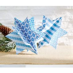 Fill your home with these fun and festive Star of David ornaments crafted out of patterned scrap...