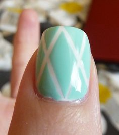 Mint green nails with white base coat and striping tape art
