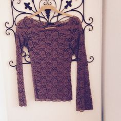 Long sleeve dress shirt See through lace top. Dark Champagne color. Bell bottom sleeves. Flower lace pattern Tops Blouses
