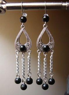 Native American black pearl earrings with stainless steel hooks. Bid $12.99