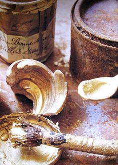 .the old cans, rusted, the worn brush full of dried paint ... and lid and the jar of french jam which must have held paint too
