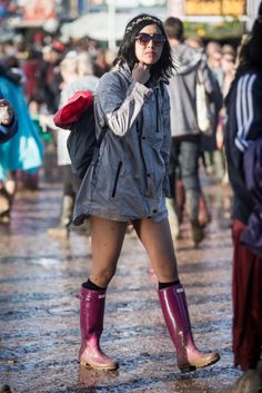 Glastonbury: where women pair Hunter boots with everything from formal dresses to shorts. See all the best street style from the festival.