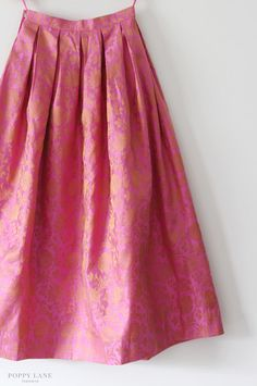 Cotton silk mix skirt in a bright pink.  Good to pair with a plain white/black kurta or kameeze.  Dress down with jean jacket and flats and up with embroidered blazer and heels.