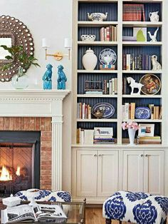 Book shelf. Love the different colored back ground including the textured look. Knick knacks EVERYWHERE to add contrast