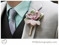 Unique and refreshing: Mark's boutonniere featuring a colorful jute-wrapped succulent at his wedding to Sam at Tyler - by Buttercup: JFAB Photography.