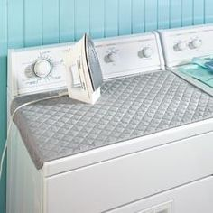 USE YOUR WASHER OR DRYER AS AN IRONING BOARD: An Ironing Mat turns the top of your washer or dryer into an ironing surface so that clothes can be pressed as soon as they come out of the dryer. Heat resistant quilted pad holds securely in place with strong magnets on the ends and the extra wide surface makes ironing a breeze.     • Easy to store: Fold, roll or hang with included loop  • Heat-resistant cover is 80% polyester/20% cotton with 100% polyester fill