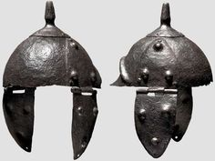 East Celtic iron helmet, 3rd/2nd century B.C. Iron skull hammered in one piece. Riveted crest plate with rod-shaped support for the helmet decoration. Neck-guard set-off by an embossed shoulder. The sides with large, riveted cheek piece hinges. The attached cheek pieces with three ornamental bosses each. Height 34 cm. Private collection, from Hermann Historica auction