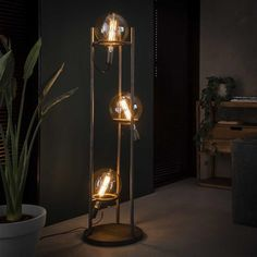 This industrial floor lamp is finished in old silver which gives the lamp a vintage touch. It has 3 light bulbs for a special illuminating effect. Retro Floor Lamps, Industrial Floor Lamps, Led Floor Lamp, Retro Lighting, Home Lighting, Rustic Room, Wood Lamps, Antique Lamps, Ideas